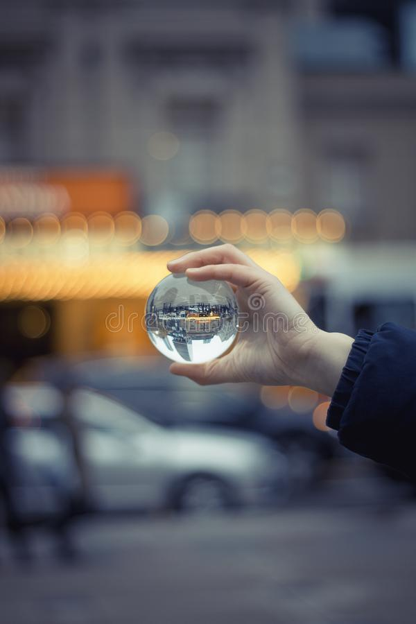 Person Holding Round Glass Ball Macro Shot stock image