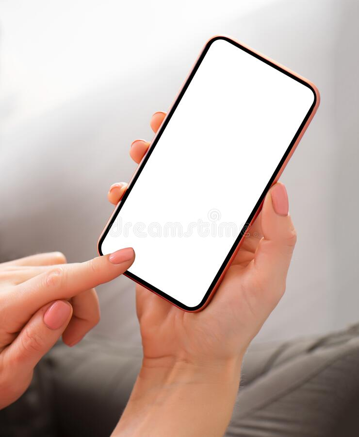 Person holding smartphone with blank screen. In hands stock image