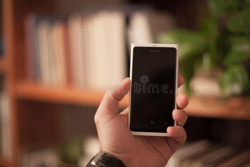 Person holding a smartphone royalty free stock photo