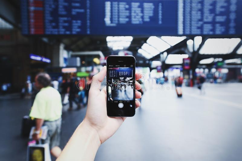 Person Holding Space Gray Iphone 5s on Camera Application stock images