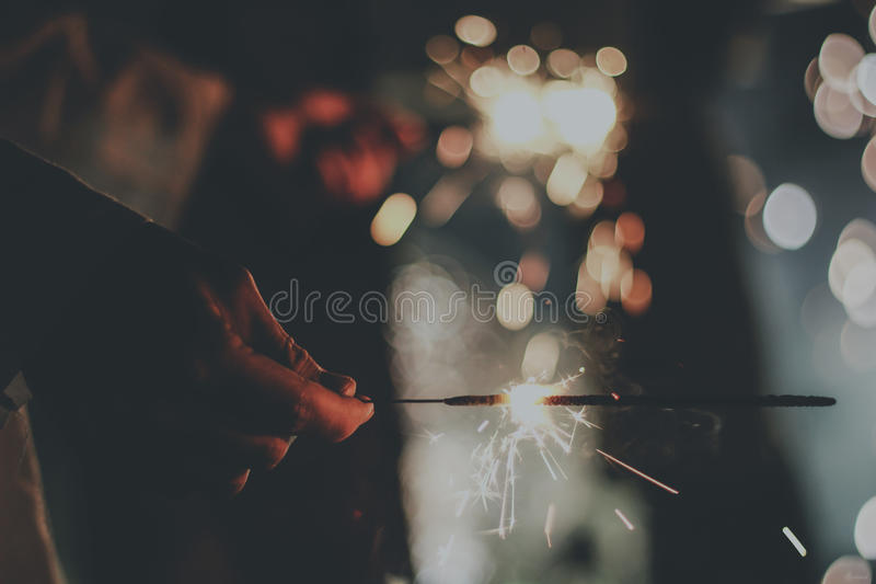 Person Holding Sparkling Stick Free Public Domain Cc0 Image