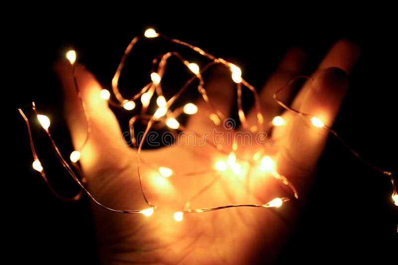 Person Holding String Lights royalty free stock images