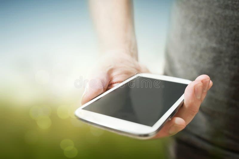Person Holding um telefone celular fotos de stock