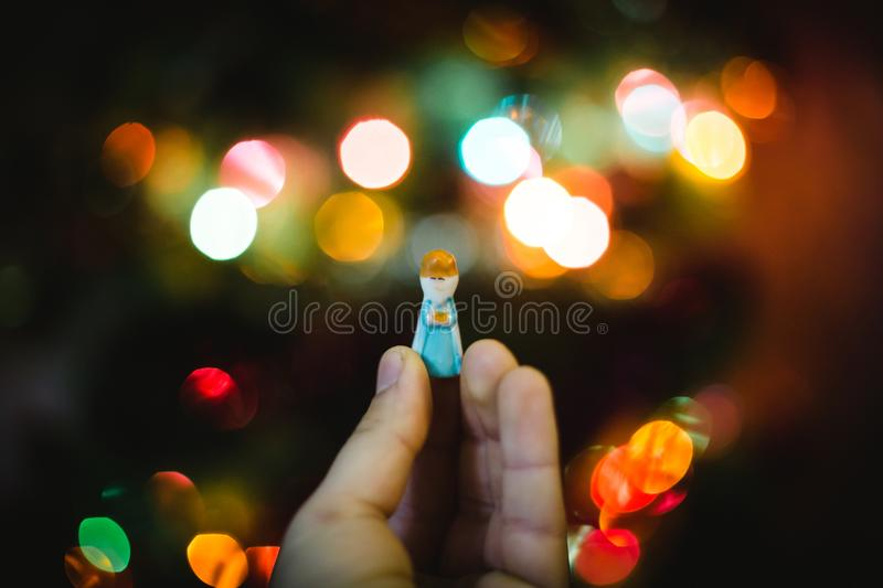 Person Holding Woman Wearing Dress Plastic Toy stock images