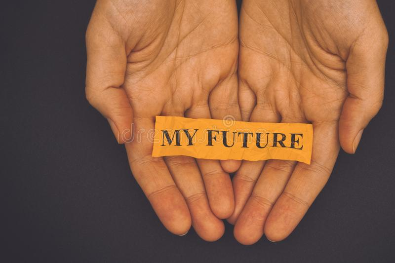 Person holds piece of paper with phrase My Future royalty free stock image