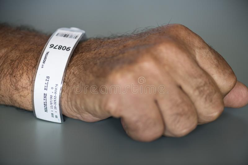 Person With Hospital Tag Labeled As Madeline Ellis 90876 royalty free stock image