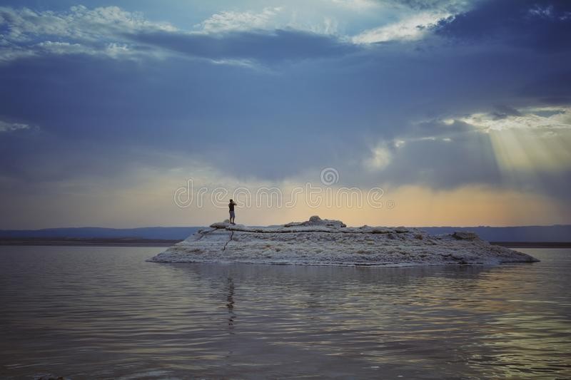 Person on Island during Sunset stock images