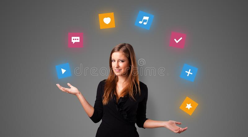 Person juggle with application icons stock photography