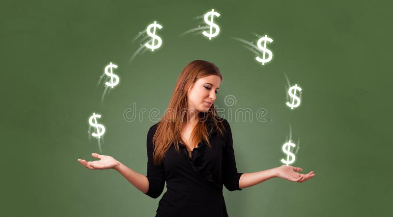 Person juggle with dollar symbol royalty free stock image