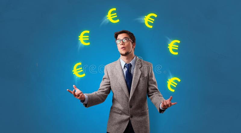 Person juggle with euro symbol stock photos