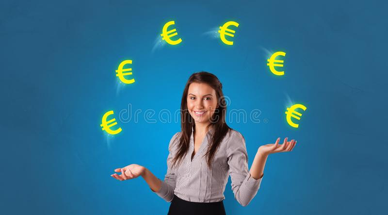 Person juggle with euro symbol stock photo