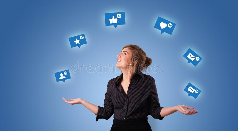 Person juggle with social media symbols. Young person playing with social media symbols royalty free stock image