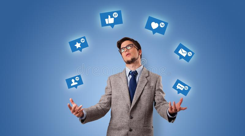 Person juggle with social media symbols royalty free stock image