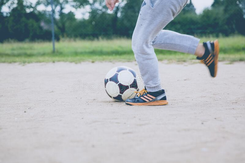 Person Kicking Soccer Ball On Gray Sand Free Public Domain Cc0 Image