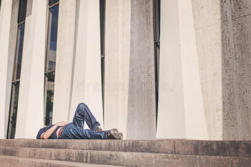 Person laying on outdoor stairs royalty free stock images