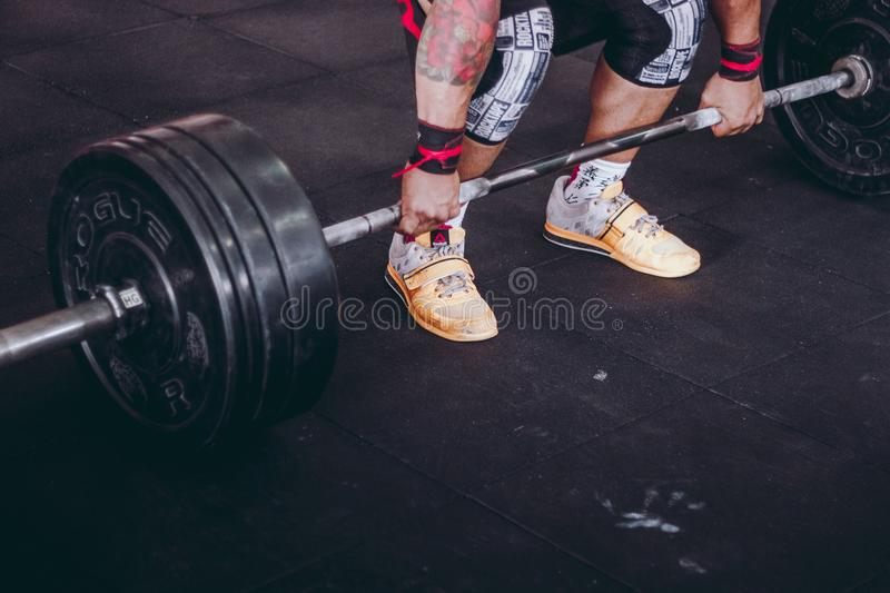 Person Lifting Black and Gray Metal Barbell royalty free stock images