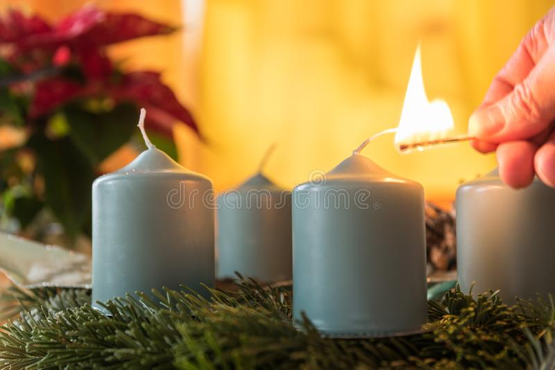 Light the candle on the Advent wreath stock photography