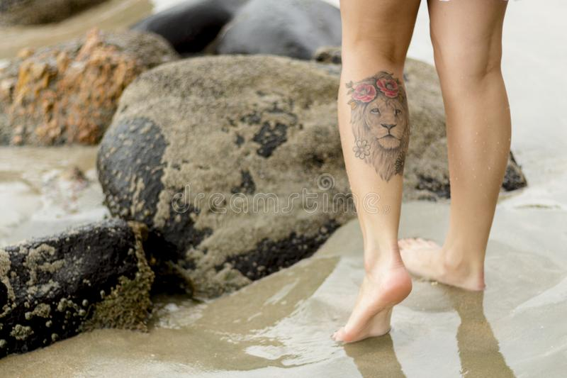 Person With Lion Tattoo stock photo