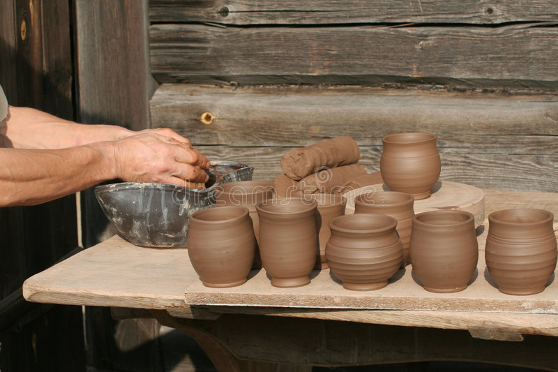 Person making pottery royalty free stock photography