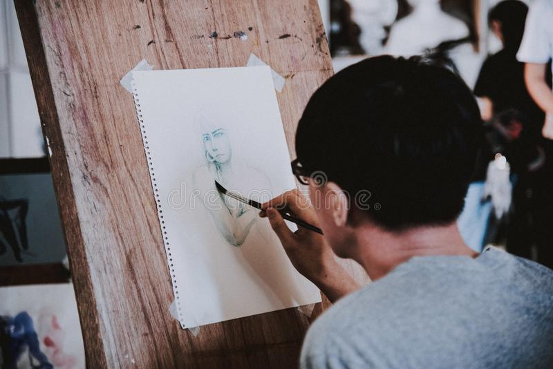 Person Making Some Human Sketch stock images
