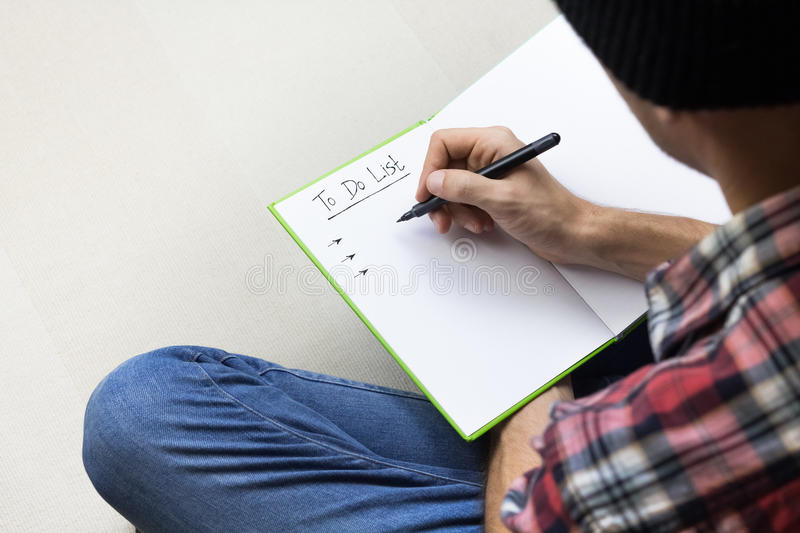 Person making to do list royalty free stock image