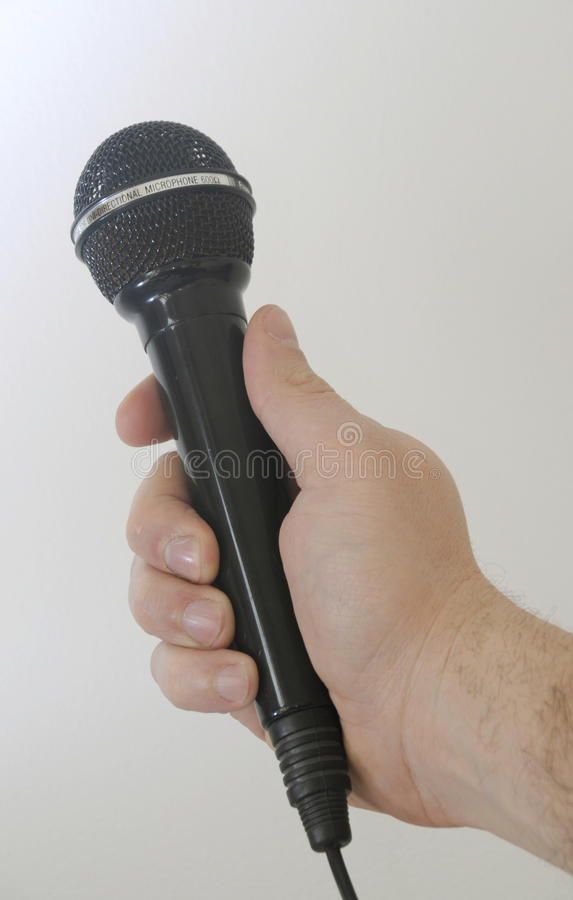 Person with microphone stock images