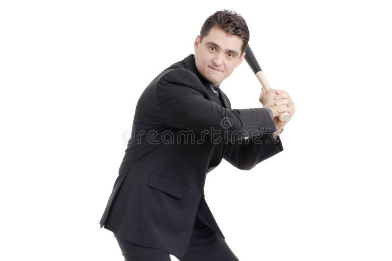 Person mit einem Baseballschläger, der sich vorbereitet zu schlagen lizenzfreie stockbilder