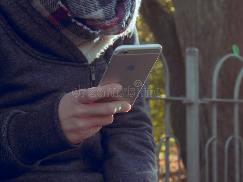 Person with mobile phone outdoors royalty free stock photo