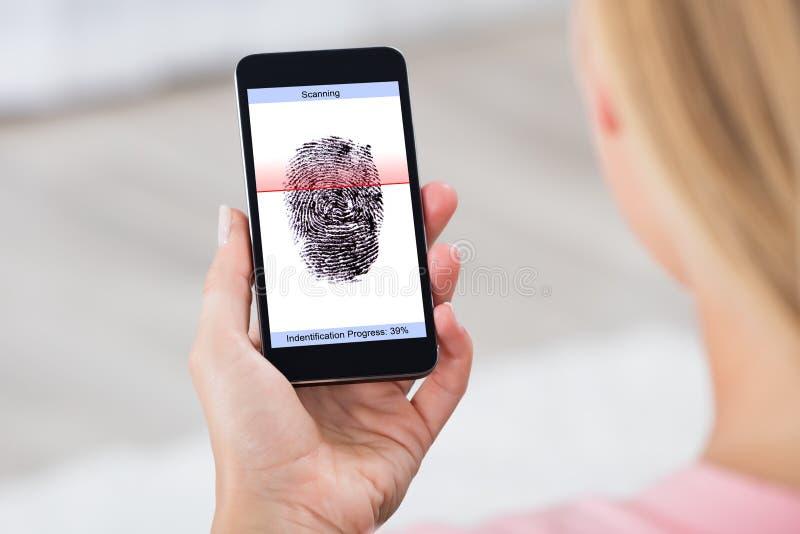 Person With Mobile Phone Showing fingeravtryckbildläsare fotografering för bildbyråer