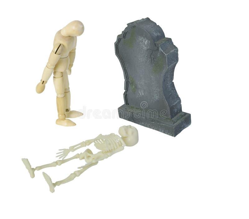 Person Mourning na lápide com esqueleto fotografia de stock royalty free