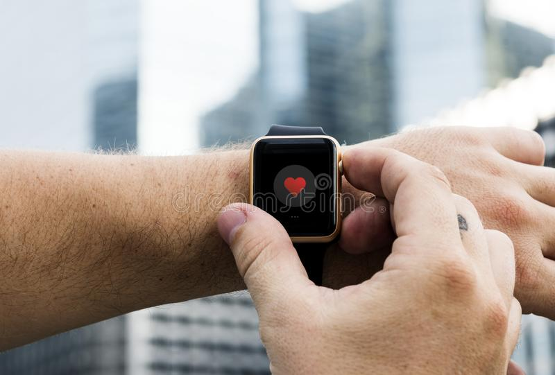 Person Operating Smartwatch stock images
