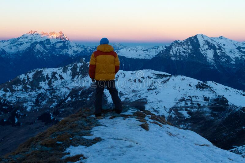 Person In Orange And Red Winter Jacket On Top Of Snow Covered Mountain Free Public Domain Cc0 Image