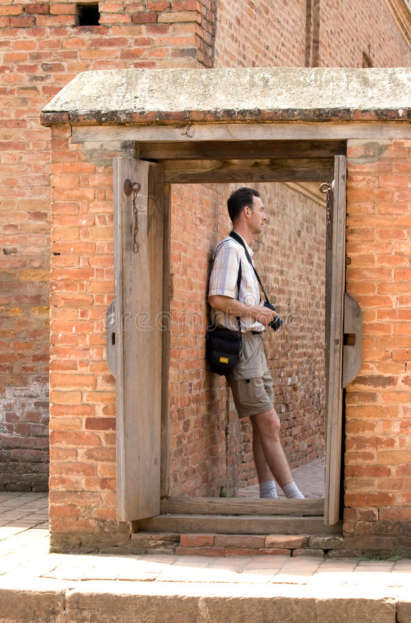 Download Person over doorway. stock image. Image of stones, doorway - 13588825