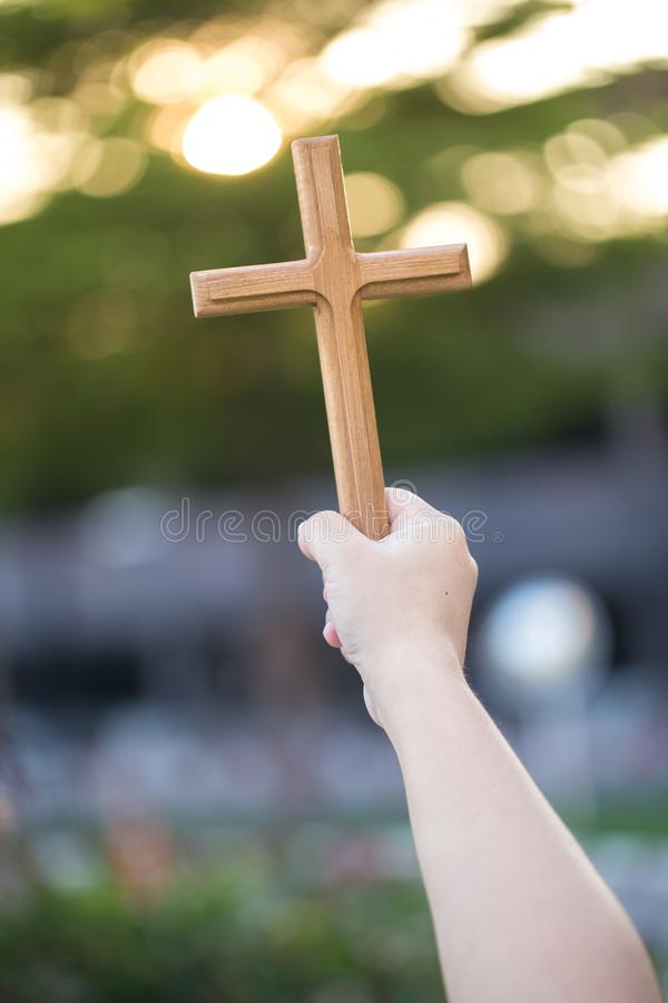 Person palm hands to hold holy cross, crucifix to worship. christian in catholic Eucharist bless god ceremony. People and religion royalty free stock photo