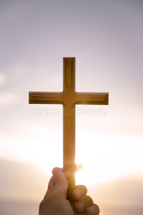 person palm hands to hold holy cross, crucifix to worship. stock image