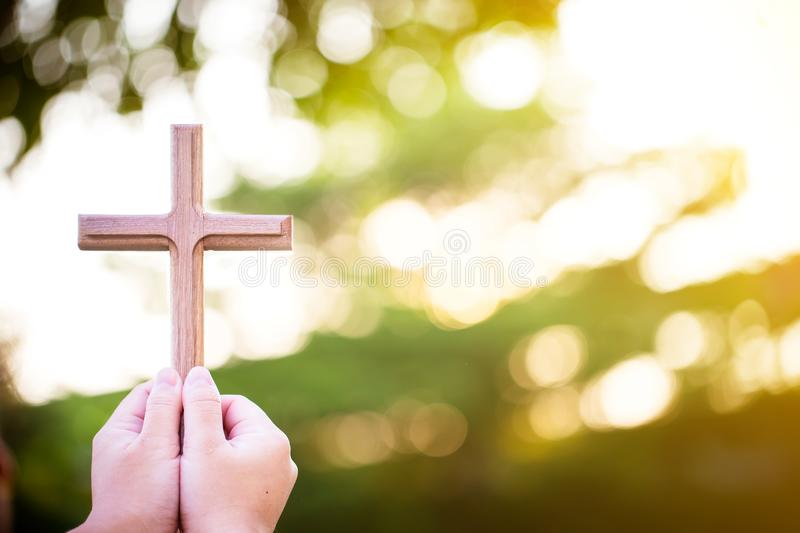 Person palm hands to hold holy cross, crucifix to worship. Christian in catholic Eucharist bless god ceremony. people and religion concept. image for sign and royalty free stock photos