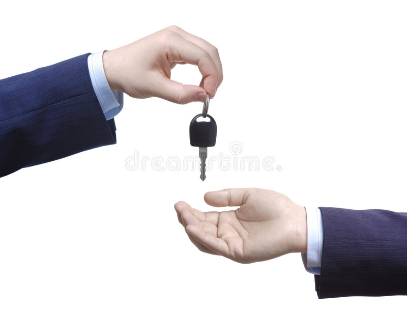Person passing car keys. Against white background royalty free stock photos