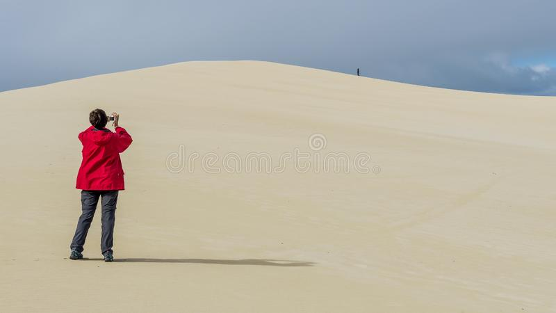 Person photographs the sand dunes of the Little Sahara desert on Kangaroo Island, Southern Australia royalty free stock photo
