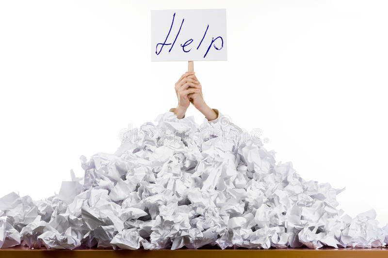 Person in pile of papers royalty free stock photos