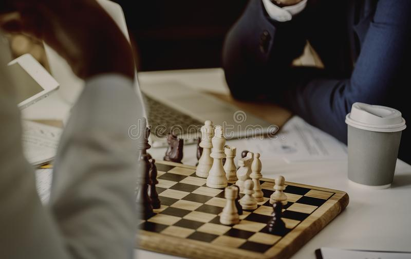 Person Playing Chessboard Set royalty free stock photo