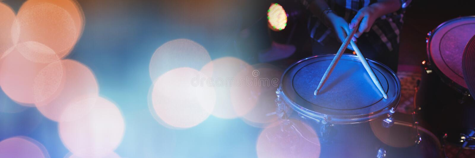Person playing drums with yellow lights. Digital composite of Person playing drums with yellow lights royalty free stock photo