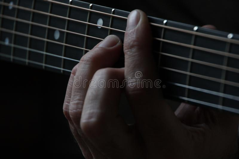 Person Playing Guitar And Holding The Cord Using Left Hand Free Public Domain Cc0 Image