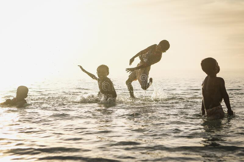 4 Person Playing In Ocean During Daytime Free Public Domain Cc0 Image