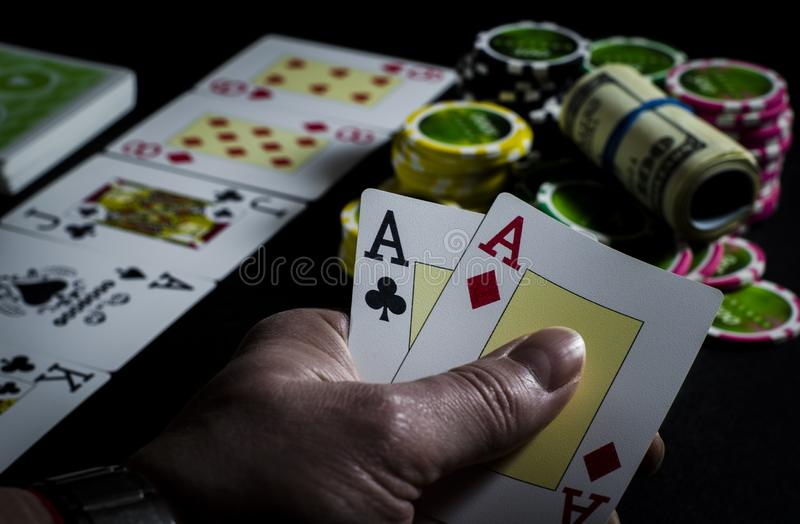 Person looking at their cards in poker