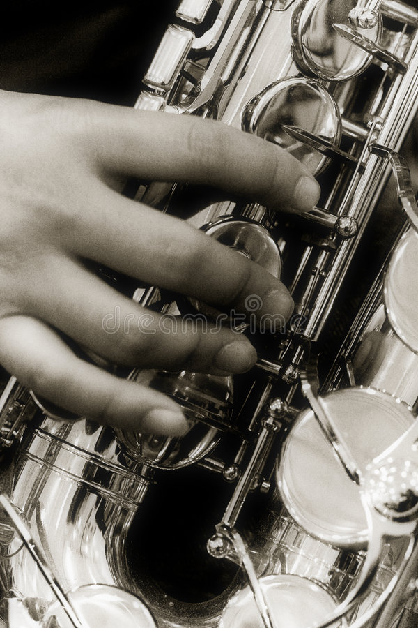 Person playing a saxophone royalty free stock images