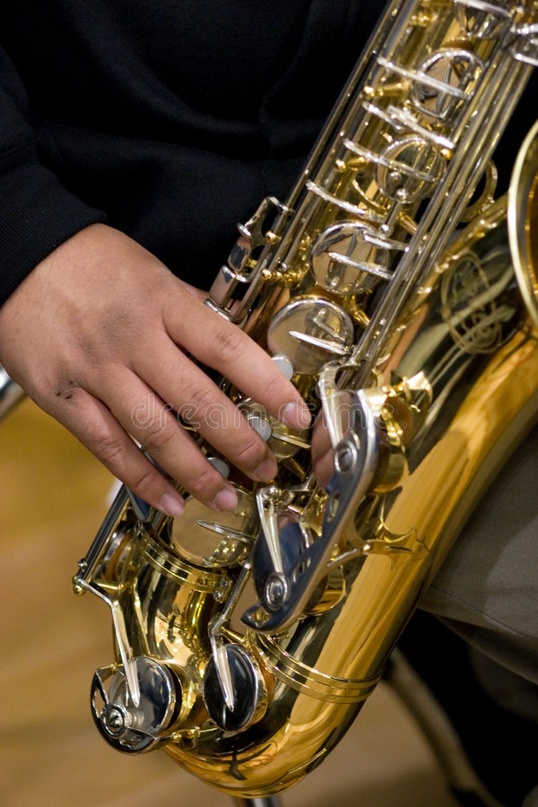 Person playing a saxophone. A person playing a saxophone stock photo
