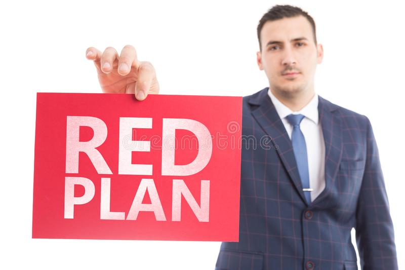 Person presenting red plan paper stock images
