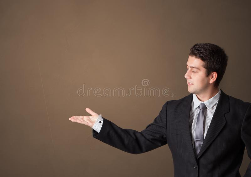 Person presenting something with empty space stock photo