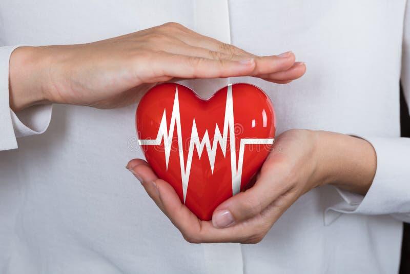 Person Protecting Heart royaltyfria bilder