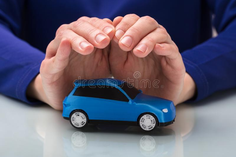 Person Protecting Small Car royalty-vrije stock foto